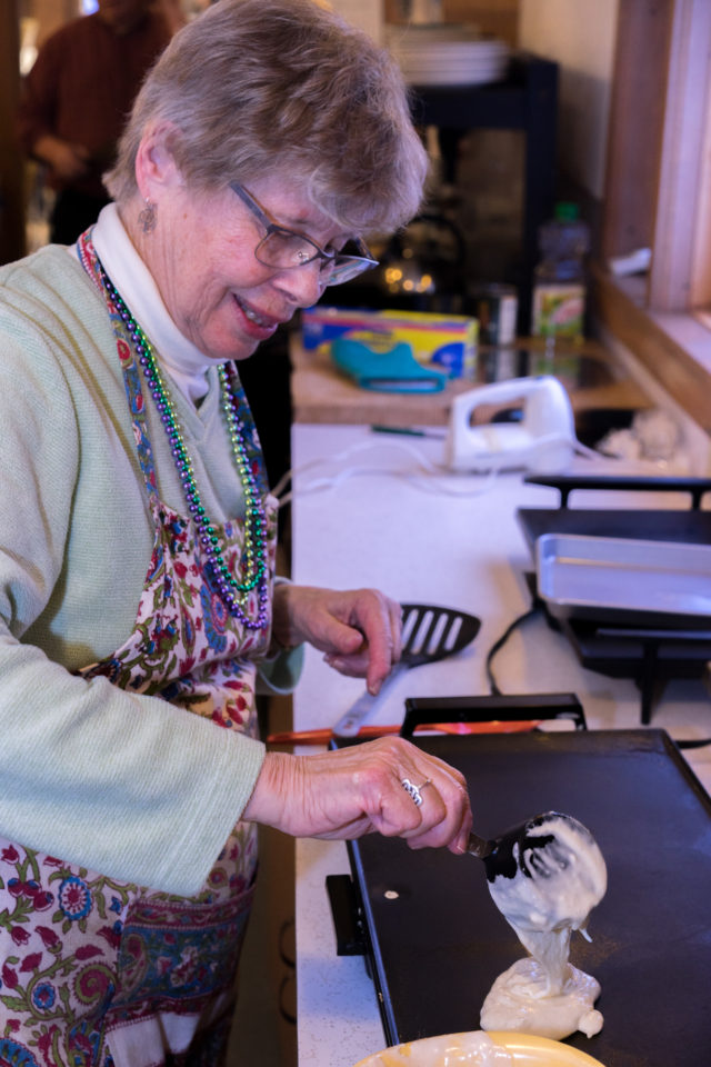 Nancy begins a fresh batch of pancakes