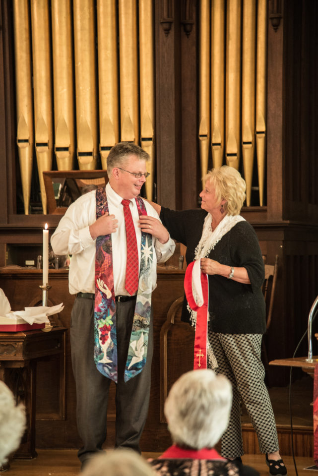 Reverend Ed Sunday-Winters receives Judy Dales-quilted stole from Shelly